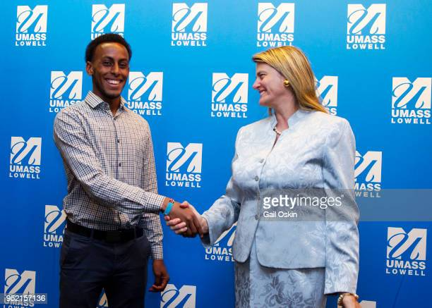 Scholarship recipient Abdi ShariffHassan and previous UMass Lowell Alumni Award Honoree Bonnie Comley attend the Honorary Alumni Award Ceremony at...