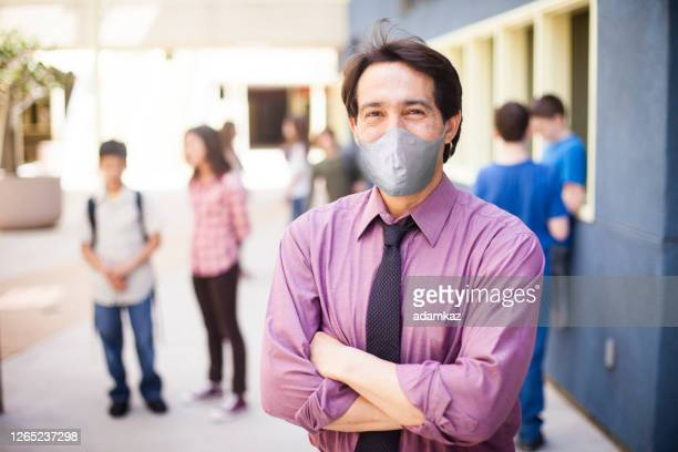 school administrator wearing a mask - adamkaz stock pictures, royalty-free photos & images