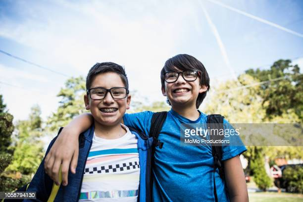 School age brothers laughing outdoors