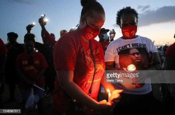 School alumni and residents participate in a candlelight vigil honoring George Floyd on the football field of Jack Yates High School on June 8 2020...