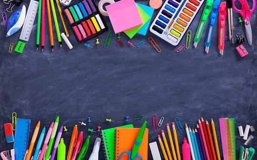 School And Office Supplies On Blackboard 999271266
