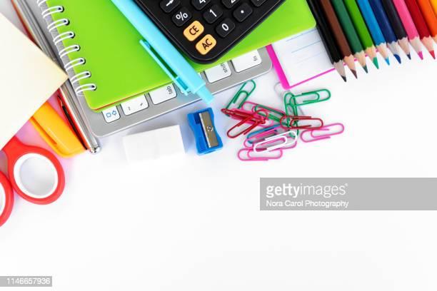 school and office supplies on white background - schulbedarf stock-fotos und bilder