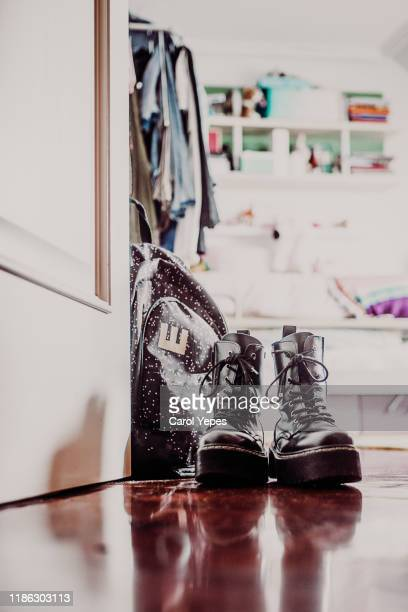 school backpack and shoes on floor indoor - open backpack stock pictures, royalty-free photos & images