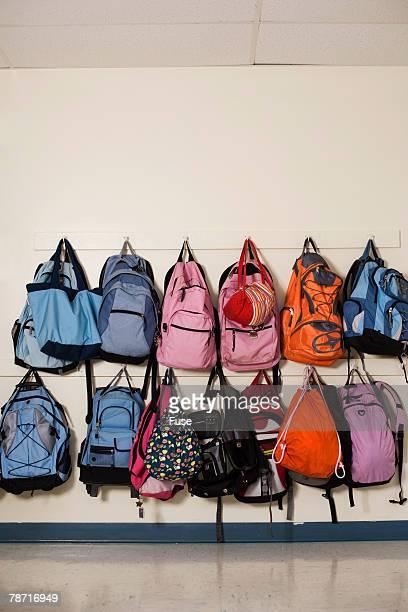School Backpacks Hanging on Wall Hooks