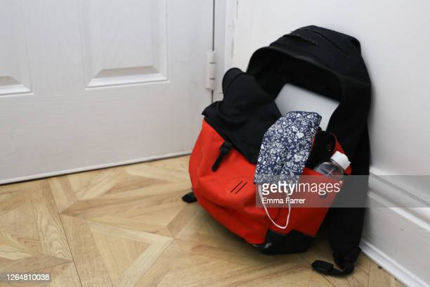 school bag with face mask for use during the covid 19 coronavirus pandemic - education stock pictures, royalty-free photos & images