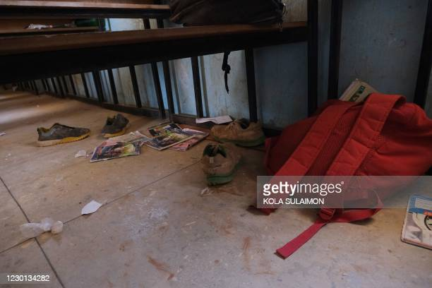 School bags and wares belonging to pupils at the Government Science school are seen on the floor where gunmen abducted students, in Kankara, in...