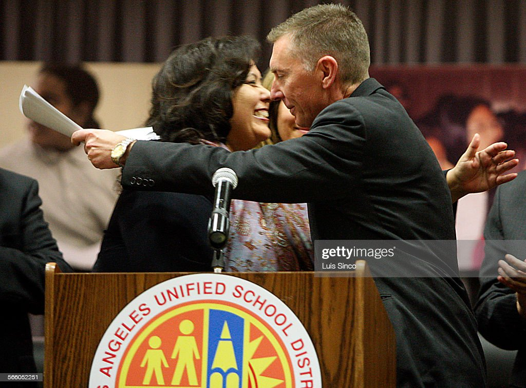 School Board President Monica Garcia hugs John Deasy, who was named superintendent of the Los Angel : News Photo