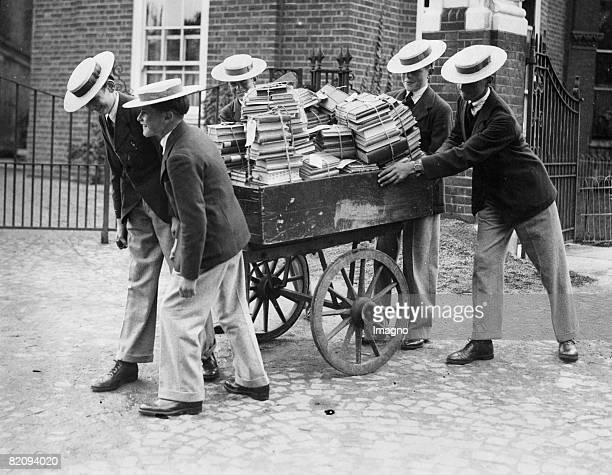 School book supply in the Harrow School A group of pupils of the Harrow School bringing the books in a car to the classrooms England Photograph91930...