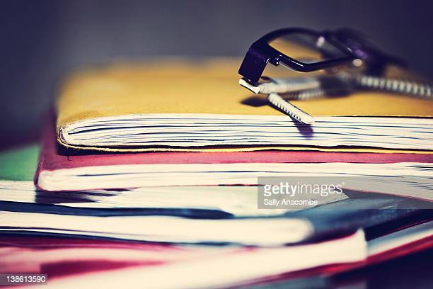 School books and pair of glasses