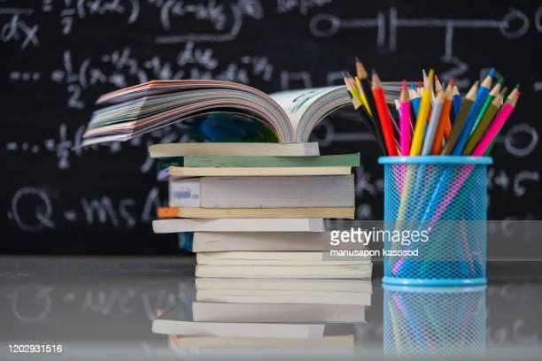 school books on desk, education concept. - schulbuch stock-fotos und bilder
