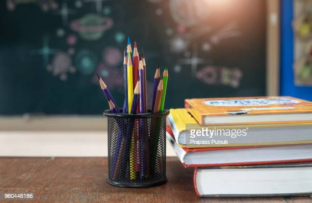 school books on desk, education concept - textbook stock pictures, royalty-free photos & images