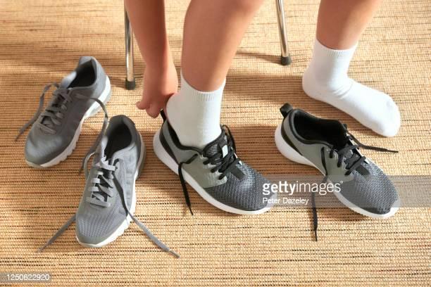 school boy in shoe shop - 8歳から9歳 ストックフォトと画像