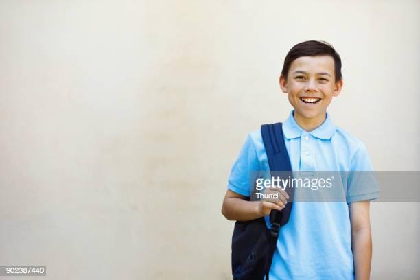 school boy - school uniform stock pictures, royalty-free photos & images