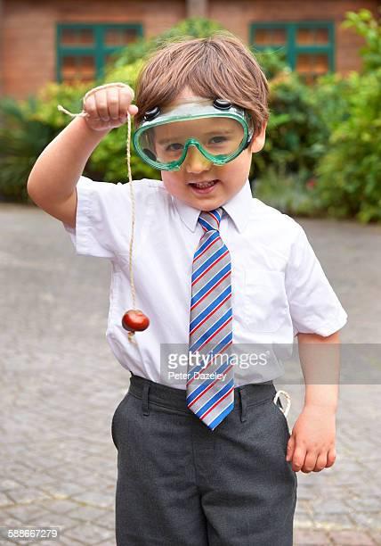 school boy playing conkers - patio de colegio imagens e fotografias de stock