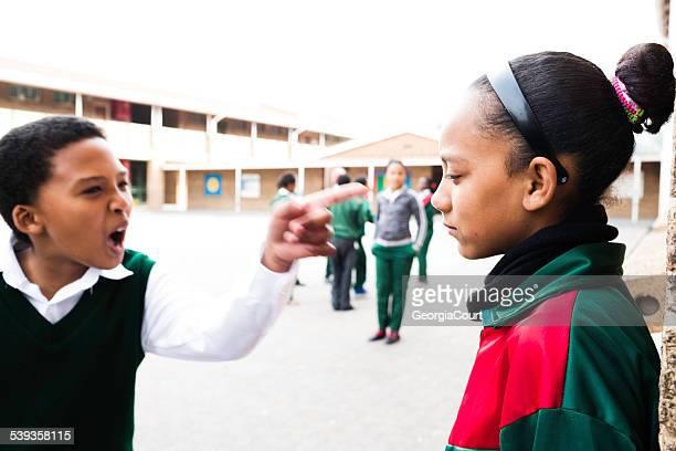 School boy shouting at girl