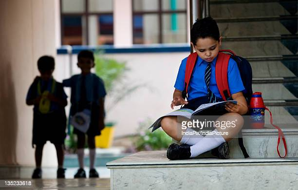 School boy sitting on the stairs