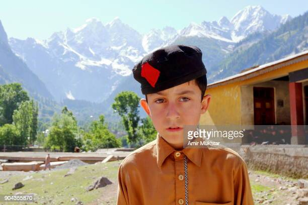 a school boy standing infront of mountains - swat valley stock pictures, royalty-free photos & images