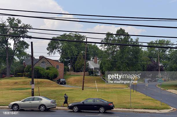 SPRING MD SEPTEMBER A school boy walks past a grassy patch where the Maryland Transit Administration is proposing to build an electrical substation...