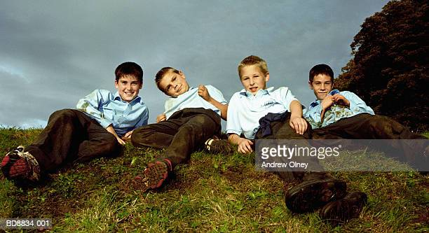 School boys (12-14) lying on grass, portrait