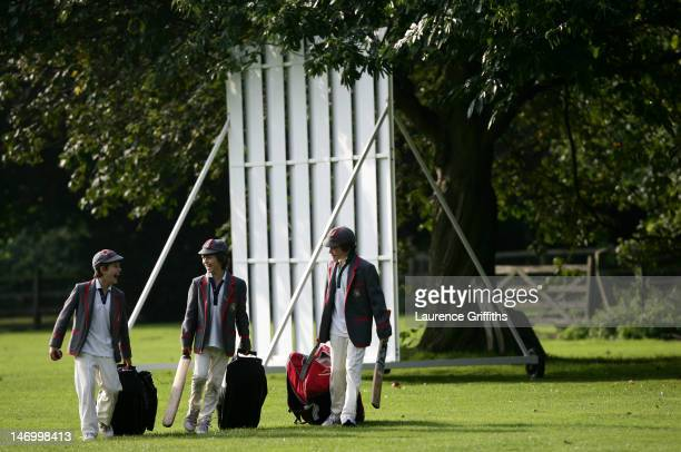 School boys play on the boundary's edge after a game of cricket on August 20 2008 in the village of Thurgaton England