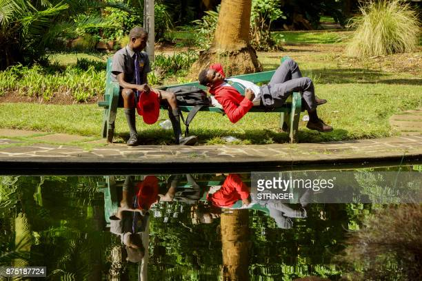 TOPSHOT School boys relax in a park in Harare on November 17 2017 Zimbabwe's former vice president whose sacking last week triggered the military's...