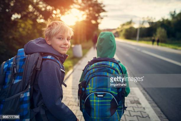 school boys walking to school - schoolboy stock pictures, royalty-free photos & images