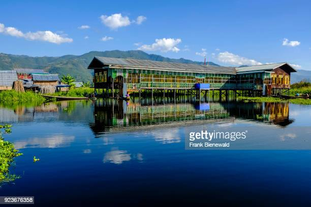 A school building is built on stilts between the swimming gardens in the village of Maing Thauk on Inle lake