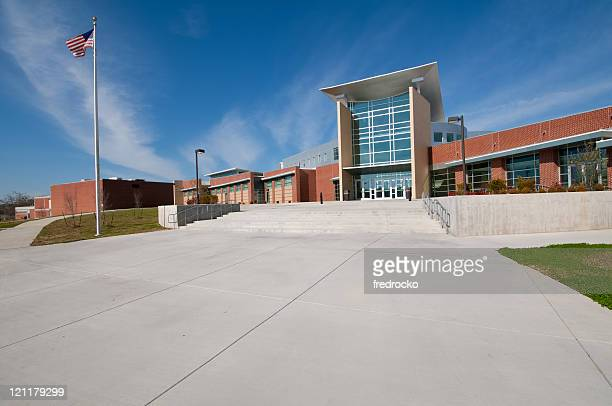 school building or business building with american flag - buildings stock pictures, royalty-free photos & images