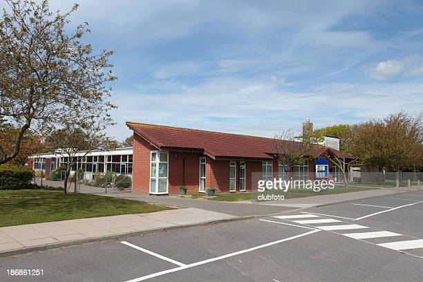 school building,  uk infant/junior 5-11years - britain playgrounds stock pictures, royalty-free photos & images