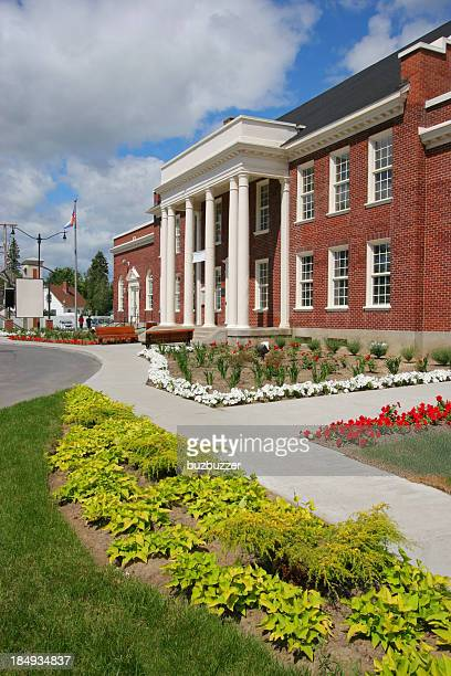 School building with columns and flowers