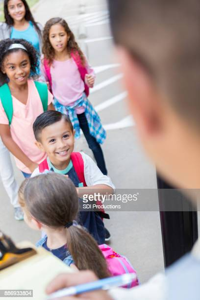 School bus driver greets school children