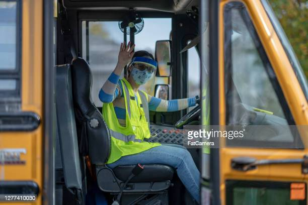 school bus driver wearing protective wear during covid-19 - school bus stock pictures, royalty-free photos & images
