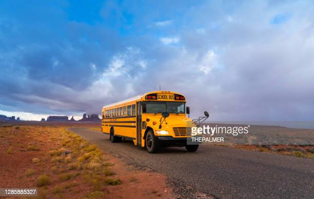 school bus driving on monument valley arizona usa - school bus stock pictures, royalty-free photos & images