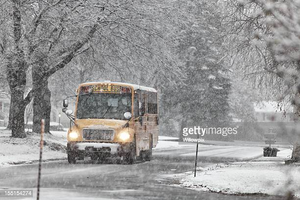 school bus in winter blizzard - desaturated stock pictures, royalty-free photos & images
