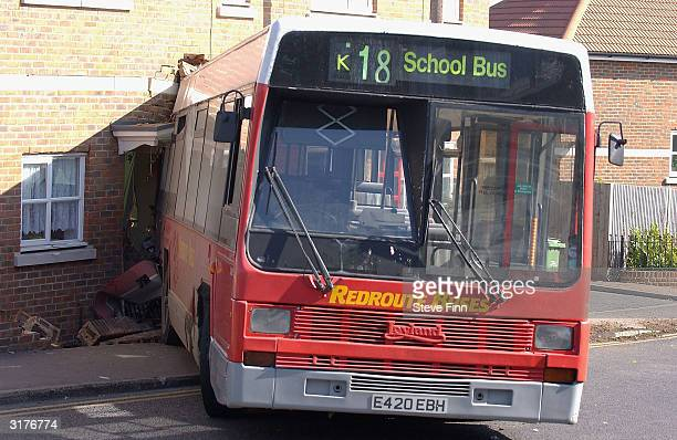 School bus is pictured after crashing into a house on March 31, 2004 in Longfield, England. The bus hit a car and smashed into a group of terraced...