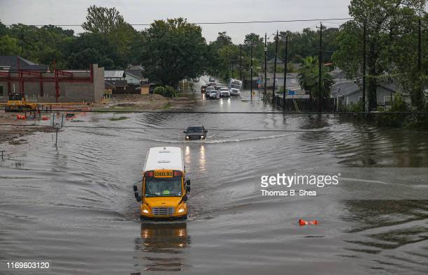 A school bus makes its way on the flooded Hopper Rd on September 19 2019 in Houston Texas Gov Greg Abbott has declared much of Southeast Texas...