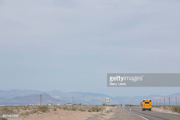 School bus on South Highway Amargosa Nevada Each school day nearly half a million school buses transport 30 million children to and from school and...