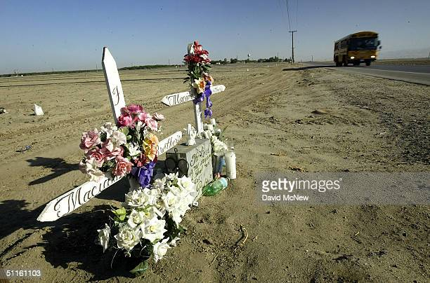 A school bus passes roadside memorial crosses on August 11 2004 near the town of Arvin southeast of Bakersfield California Californias Central Valley...