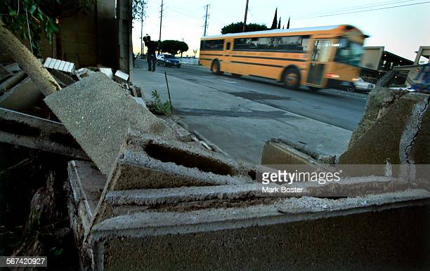 A school bus rolls past the site on East Street in Anaheim where a man and woman were killed and a teenage boy was critically injured when the driver...