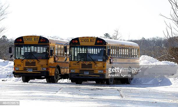 School buses after the winter storm Janus Connecticut United States January 22 2014 Janus left 4 deaths and dropped over 30cm snow in northeastern...
