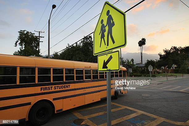 School buses are driven to pick up children before classes begin on October 10 2008 in Pasadena California California State Treasurer Bill Lockyer...