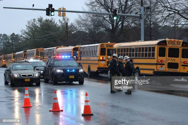 School buses are lined up in front of Great Mills High School after a shooting on March 20 2018 in Great Mills Maryland It was reported that two...