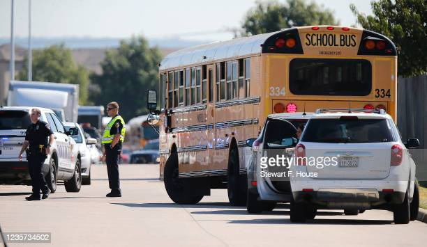 School buses are used to transport students from Timberview High School to the Mansfield ISD Center for Performing Arts after a shooting on campus on...