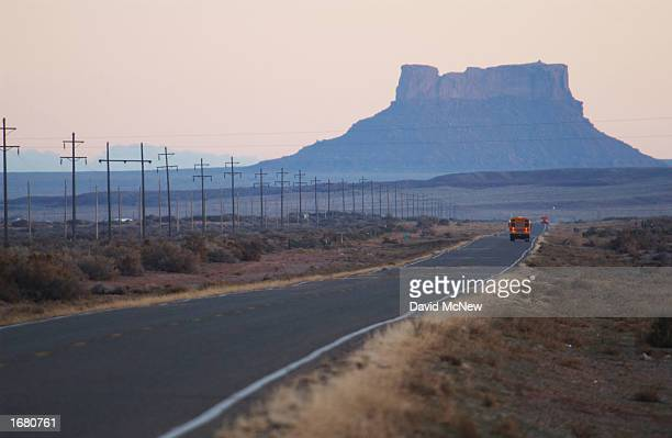 School buses carry children across the vast Navajo Nation south of Rock Point December 5 2002 on the Navajo Indian Reservation Arizona Tha Navajo...