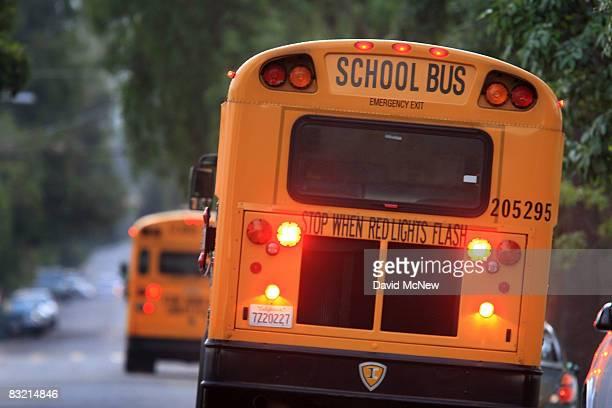School buses drive down teh road to pick up children before classes begin on October 10, 2008 in Pasadena, California. California State Treasurer...