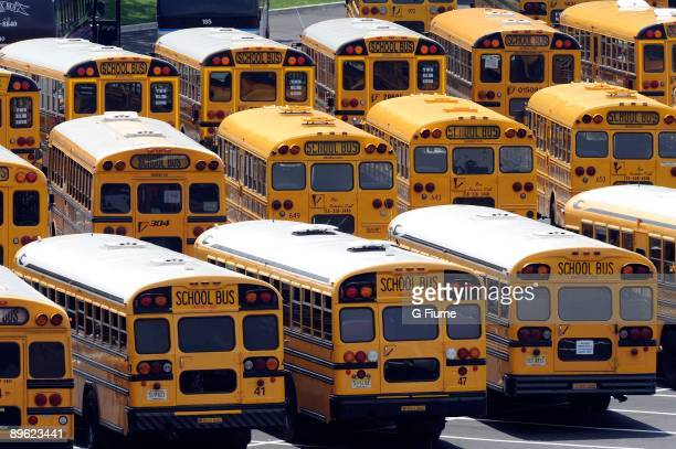 School buses stand parked in the parking lot outside Citi Field before the game between the New York Mets and the Colorado Rockies on July 30, 2009...