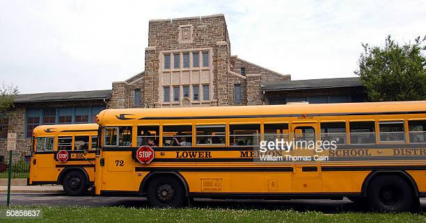 School buses stop to drop students at Merion Elementary School student May 19 2004 in Lower Merion Pennsylvania The Lower Merion School District is...