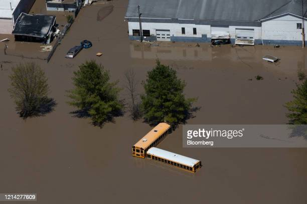 School buses submerged in flood water are seen in this aerial photograph taken after dams failed in Midland, Michigan, U.S., on Wednesday, May 20,...