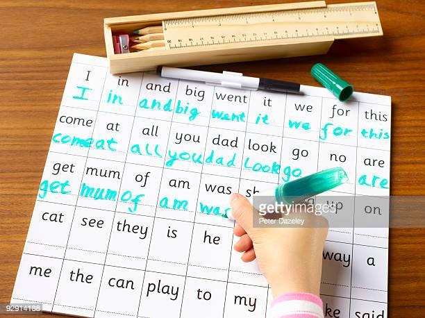 School child age 4-7 practicing handwriting.