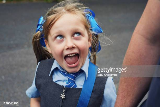 school child getting ready for school - walking stock pictures, royalty-free photos & images